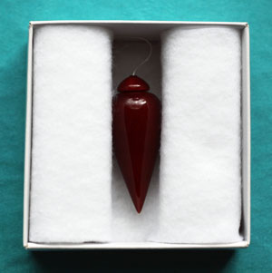 Radionic pendulum with a red lacquer